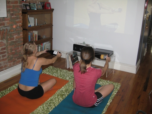 Working out with wine bottles with tv